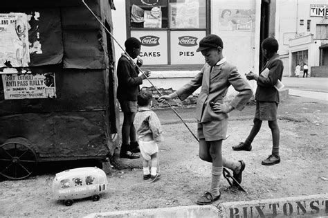 David Goldblatt Baby with childminders and dogs in the
